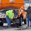 Fitchburg DPW workers fill potholes on Harvard Street Thursday afternoon. SENTINEL & ENTERPRISE/JOHN LOVE
