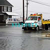 Mid tide Monday morning along Maryland Ave as a Somers Point city vehicle with two fireman in back slowly make their way out after rescue a trapped woman with the storm still 10 hours out to sea before land fall.
