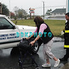 Mid tide Monday morning along Maryland Ave as a woman rescued by Somers Point city workers and two fireman slowly makes her way to a Somers Point Emergency Management vehicle with the storm still 10 hours out to sea before land fall.