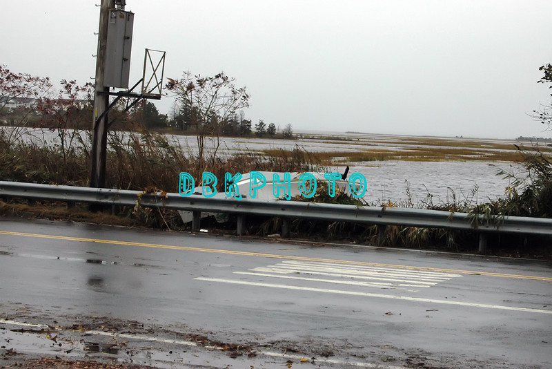 AFTER THE STORM - Tuesday 10/30/2012  The wind and rain are gone . . .boat broke loose and is only stopped by roadside guard rail.