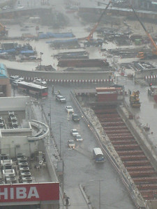 The BurJuman roundabout in Bur Dubai, taken from the business tower.  The car on the left with its lights on has stalled.