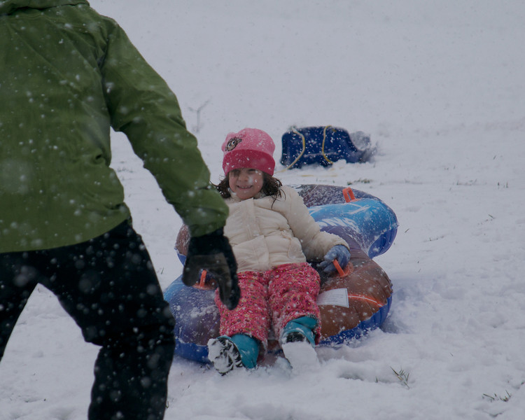 First snow, neighbors sledding in our backyard