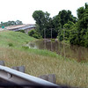 Along Hwy 79 at the Arkansas River bridge. Pine Bluff Motocross track is to the right and under water as is the access road under the water along the levy.