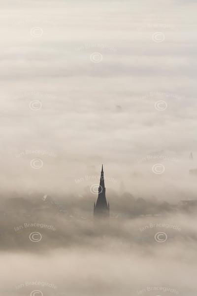 Aerial photo of Newark Parish Church in the fog.