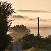 Fog Shrouding the Far Trees and Hills.