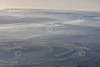 Aerial photo of a misty landscape.