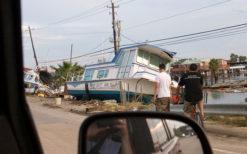 """September 14:  Boat washed up almost to NASA Parkway.  Note the message on the side of the boat.  A few days later this message was crossed off and a new message reading, """"We need help!"""" was painted on it instead."""
