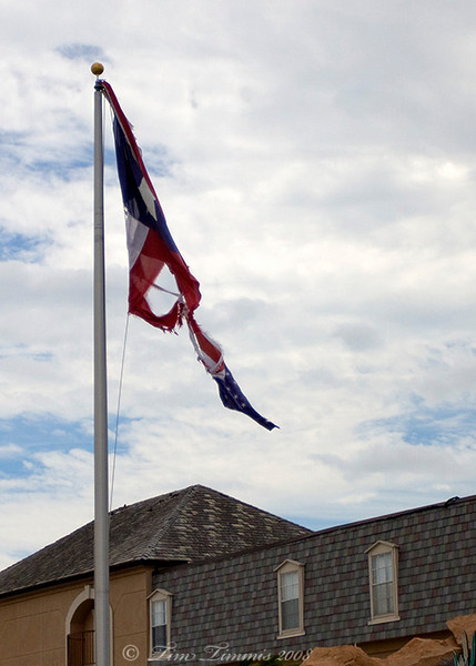 Torn Texas flag in Clear Lake