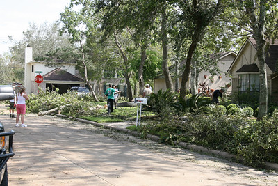Mom and Dad's house.    Clearing out 3 fallen trees surrounding the garage.