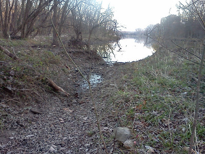 """Aftermath:  Before the flood this was a narrow drainage ditch that channeled rainwater into Lake Kittamaqundi. Now it's much wider.   On Page 4 of this gallery there are views of this area during the flood (the ones captioned """"downstream"""").  11-28-11"""