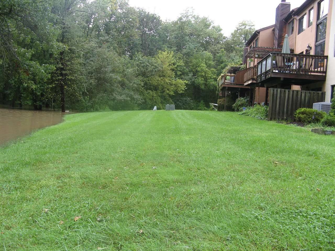 At the current edge of the lake facing west. It's even closer on this side, and there's less of a slope to the houses. We're due for more rain tonight and tomorrow -- I'm keeping my fingers crossed that these homes stay dry!<br /> <br /> 9-7-11