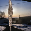 Sun Shinning Through The Glass-like Icicle.<br /> We don't often get a big icicle on the end of the guttering there, but we did this year. We never get one there in the summer time, thankfully. We could use some summer now.