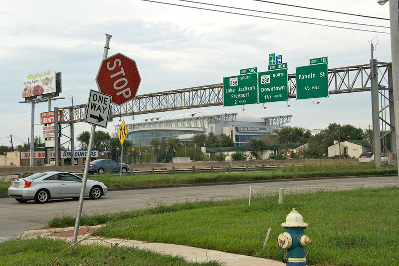 Reliant Stadium and a funky stop sign