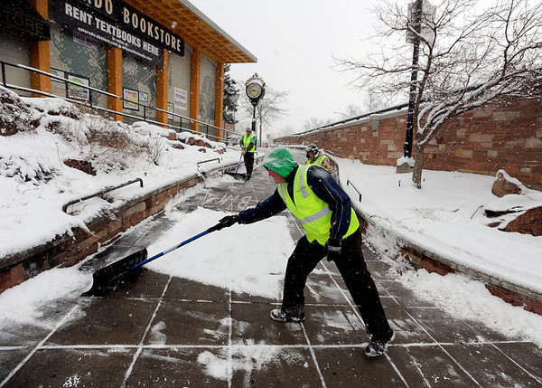 "Dennis Fee, a member of the Ready to Work crew, clears snow with other members  from the Hill area on Wednesday.<br /> For  more photos and a video of the snow, got to  <a href=""http://www.dailycamera.com"">http://www.dailycamera.com</a>.<br /> January 11, 2012 / Cliff Grassmick"