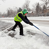 "Dennis Fee, a member of the Ready to Work crew, clears snow from the Hill area on Wednesday.<br /> For  more photos and a video of the snow, got to  <a href=""http://www.dailycamera.com"">http://www.dailycamera.com</a>.<br /> January 11, 2012 / Cliff Grassmick"
