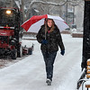 "Heidi Ekrein walks along the Pearl Street Mall to return a video on Wednesday.<br /> For  more photos and a video of the snow, got to  <a href=""http://www.dailycamera.com"">http://www.dailycamera.com</a>.<br /> January 11, 2012 / Cliff Grassmick"