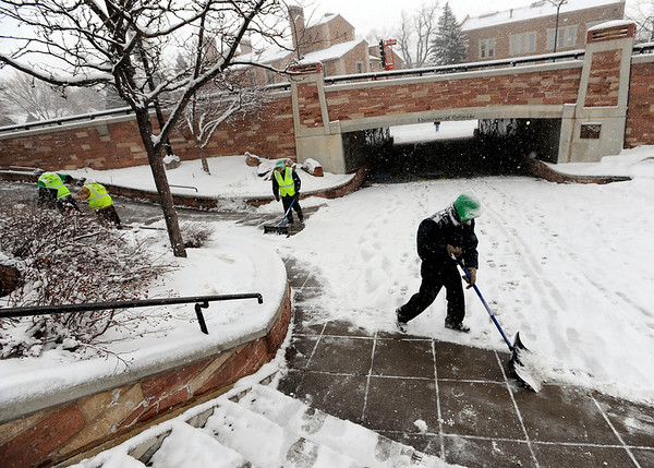 """The City of Boulder Ready to Work crew clears snow from the Hill area on Wednesday.<br /> For  more photos and a video of the snow, got to  <a href=""""http://www.dailycamera.com"""">http://www.dailycamera.com</a>.<br /> January 11, 2012 / Cliff Grassmick"""