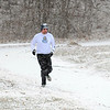 Despite the snowy weather, Paul Vella of Fitchburg continues with his running routine on Saturday morning at Coolidge Park in Fitchburg.<br /> SENTINEL & ENTERPRISE / BRETT CRAWFORD