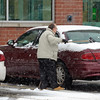 A man clears snow off the back windshield of his car after shopping at the newly opened Walgreens on John Fitch Highway in Fitchburg as snow continues to fall during a snowstorm, Saturday.<br /> SENTINEL & ENTERPRISE / BRETT CRAWFORD