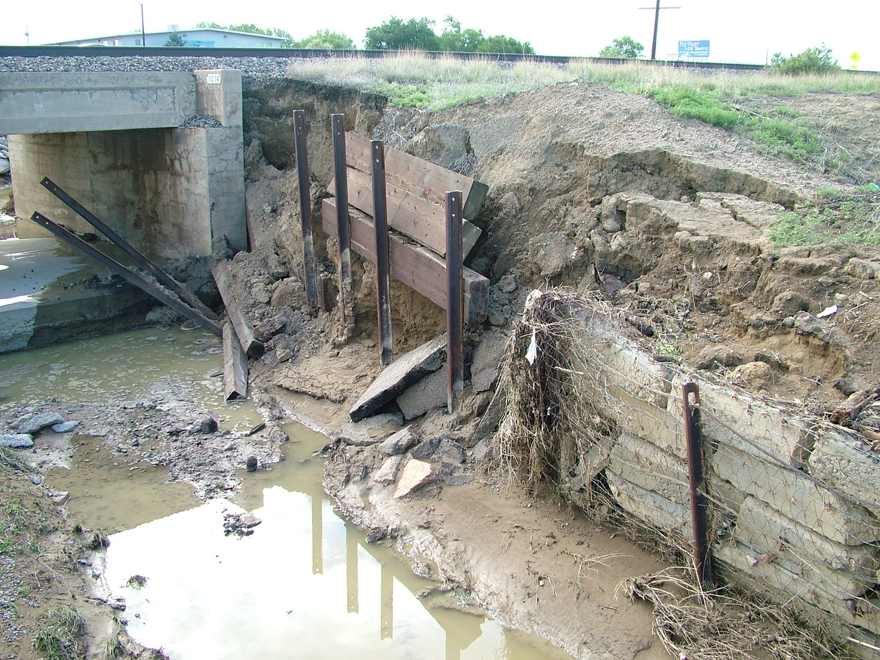 Retaining wall collapse. That bridge is for the train tracks.