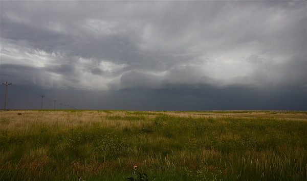 Retreated a little north for better visual of the wall cloud/mesoyclone; colorful grass fields add to the photo's lusciousness!!