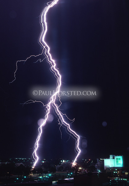 An unusual multi-channel lightning bolt strikes in downtown Rapid City, South Dakota. ©Paul Horsted, All Rights Reserved.