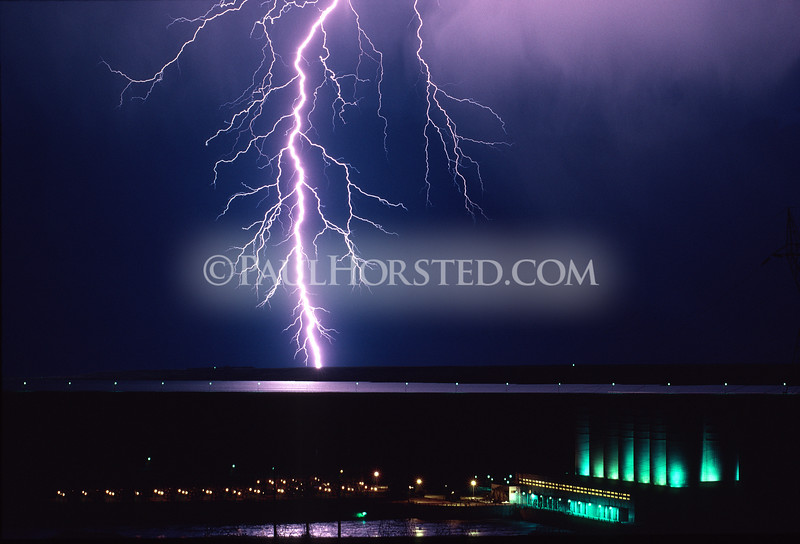 A huge lightning bolt above Oahe Dam north of Pierre, South Dakota. ©Paul Horsted, All Rights Reserved.