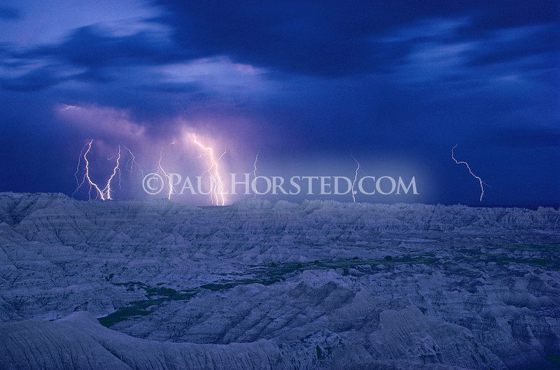 A 30-minute time exposure captures several lightning bolts as a storm moves across Badlands National Park in southwestern South Dakota. ©Paul Horsted, All Rights Reserved.