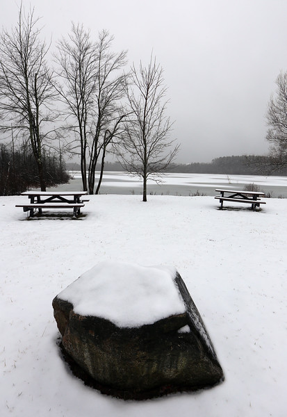 View of Long Pond from Whipple Road at Pleasant Street in Tewksbury, after light snow.  (SUN/Julia Malakie)