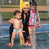 Hot weather features: spray park at Shedd Park. Mariana DaVitoria of Lowell with son Bryan DaVitoria, 18 months, and daughter Luiza DaVitoria, 3.  (SUN/Julia Malakie)
