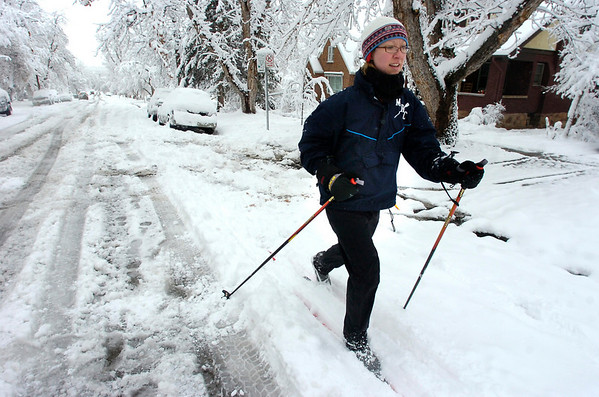 Betsy Swanner skies up 12th Street in Boulder on Wednesday March 24. Swanner took a turn around the neighborhood for some exercise before heading off to work.<br /> Photo by Paul Aiken / The Daily Camera