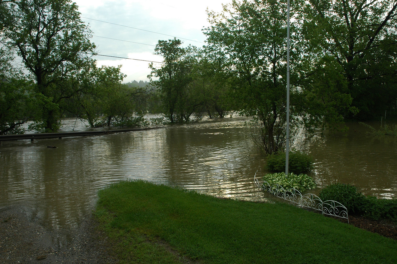 Our driveway, garden and the road in front of the house. Waterfront property today.