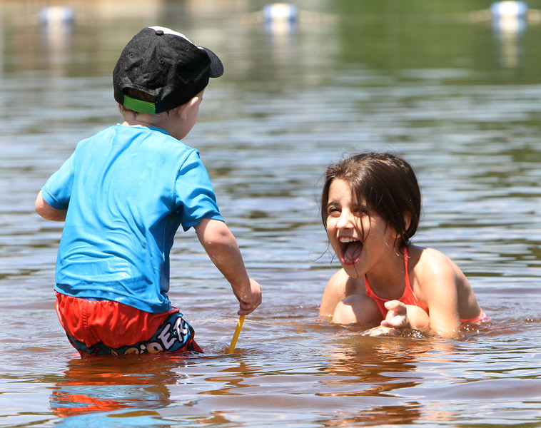 Micozzi Beach in Billerica. Logan Costa, 23 months old, and his cousin Priscilla Carralino, 10, both of Billerica. (SUN/Julia Malakie)