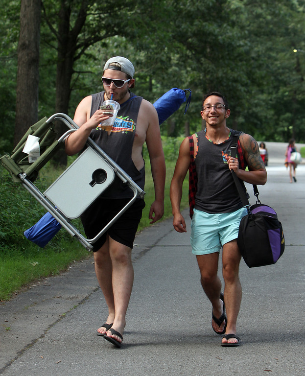 . Joey Riggie of Ware, left, and Alexander Czuprynski of Leominster, head for Mirror Lake in Devens to cool off on a hot afternoon. (SUN/Julia Malakie)