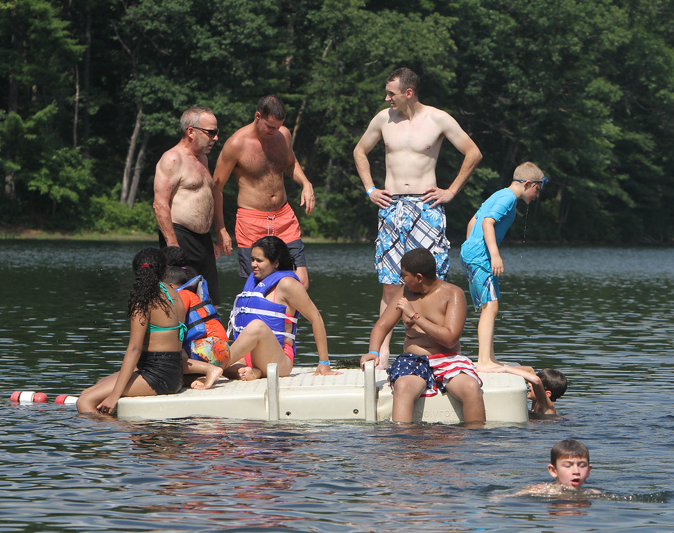 . People cool off in Mirror Lake in Devens on a hot afternoon. (SUN/Julia Malakie)