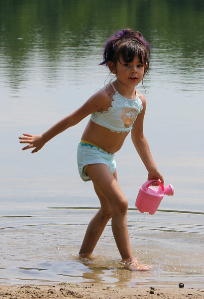 Jeralisse Garay, 5, of Fitchburg, cools off at Mirror Lake in Devens on a visit with her godmother, during a hot spell.  SUN/Julia Malakie