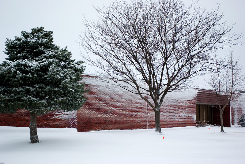 "<font size=""3"">The snow was driven hard by high winds.  The sides of this school were somewhat snow packed.</font>"