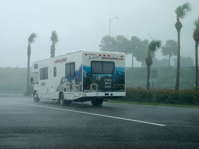 An incredible Florida storm as it exploded right above us. I was time lapsing an approaching storm from a car park adjacent to an Interstate bridge. The storm eventually passed directly over us and unleashed incredible amounts of rain and wind. Almost like being within a hurricane, but not quite. This camper truck was a lonesome object which was rocking wildly from the wind. The rain sounded like bullets. A few minutes later it was clear again.  Olympus E3, 12-60mm SWD - F8, 1/40s