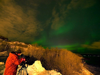 First night in Tromso. We had clear skies, headed to a fjord away from the city and hey presto, Thor's contrails came out to play. Shot of Al filming. Olympus E3, 7-14mm