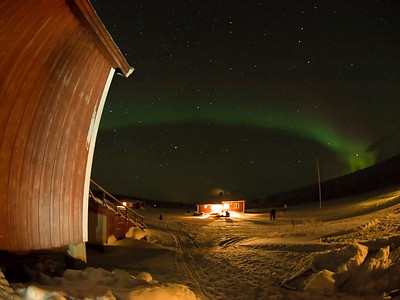 Clear skies again at base camp. Aurora or Northern Lights came out early at 6pm as a weak glow. It slowly strengthened as the night progressed culminating in a dazzling Valentine day display. I frequently used various cabins to compose and vary the angles.Olympus E3, 8mm fisheye