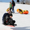 "Bob Kunze, left, and Joey Lowan, fly down the hill at Scott Carpenter Park.<br /> No school and plenty of snow at Scott Carpenter Park in Boulder, equals sledding.<br /> For a video and more photos of sledding, go to  <a href=""http://www.dailycamera.com"">http://www.dailycamera.com</a>.<br /> December 27, 2011 / Cliff Grassmick"