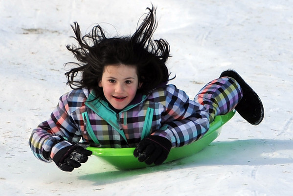 "Amira Metzger, 8, heads down the hill at Scott Carpenter Park on Tuesday.<br /> No school and plenty of snow at Scott Carpenter Park in Boulder, equals sledding.<br /> For a video and more photos of sledding, go to  <a href=""http://www.dailycamera.com"">http://www.dailycamera.com</a>.<br /> December 27, 2011 / Cliff Grassmick"