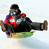 "Jake and Jessica Frichtel get airborne while sledding on Tuesday.<br /> No school and plenty of snow at Scott Carpenter Park in Boulder, equals sledding.<br /> For a video and more photos of sledding, go to  <a href=""http://www.dailycamera.com"">http://www.dailycamera.com</a>.<br /> December 27, 2011 / Cliff Grassmick"