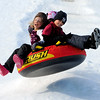 "Rowan Ellis-Rissler, left, Kenny Jew, and Darcy Jew, in back, get some air at Scott Carpenter Park on Tuesday.<br /> No school and plenty of snow at Scott Carpenter Park in Boulder, equals sledding.<br /> For a video and more photos of sledding, go to  <a href=""http://www.dailycamera.com"">http://www.dailycamera.com</a>.<br /> December 27, 2011 / Cliff Grassmick"