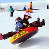 """Rowan Ellis-Rissler, left, and Darcy Jew, fly over a bump at Scott Carpenter Park on Tuesday.<br /> No school and plenty of snow at Scott Carpenter Park in Boulder, equals sledding.<br /> For a video and more photos of sledding, go to  <a href=""""http://www.dailycamera.com"""">http://www.dailycamera.com</a>.<br /> December 27, 2011 / Cliff Grassmick"""