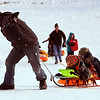 """Bayu Arjana, left, pulls his son, Milo, and friend Koen Widom, up the hill at Scott Carpenter Park on Tuesday.<br /> No school and plenty of snow at Scott Carpenter Park in Boulder, equals sledding.<br /> For a video and more photos of sledding, go to  <a href=""""http://www.dailycamera.com"""">http://www.dailycamera.com</a>.<br /> December 27, 2011 / Cliff Grassmick"""
