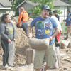 People filling up sandbags was a common site as residents took advantage of the sand pile next to Pauls Valley's fire station to prepare in case flooding became a real threat to their homes.  (PV Democrat photo by Barry Porterfield)