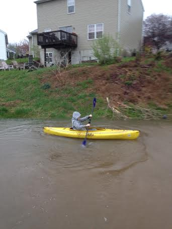 Brian Stevens age 10 kayaking in back yard in Sanatoga.<br /> <br /> submitted by Chris Stevens