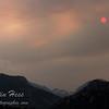 A red-orange sun setting over Estes Park, Colorado.
