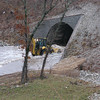 The tunnel under St Rt 65, by the Saddlebrooke office.  I don't think he's going to be able to move all the water, no matter how hard he tries.